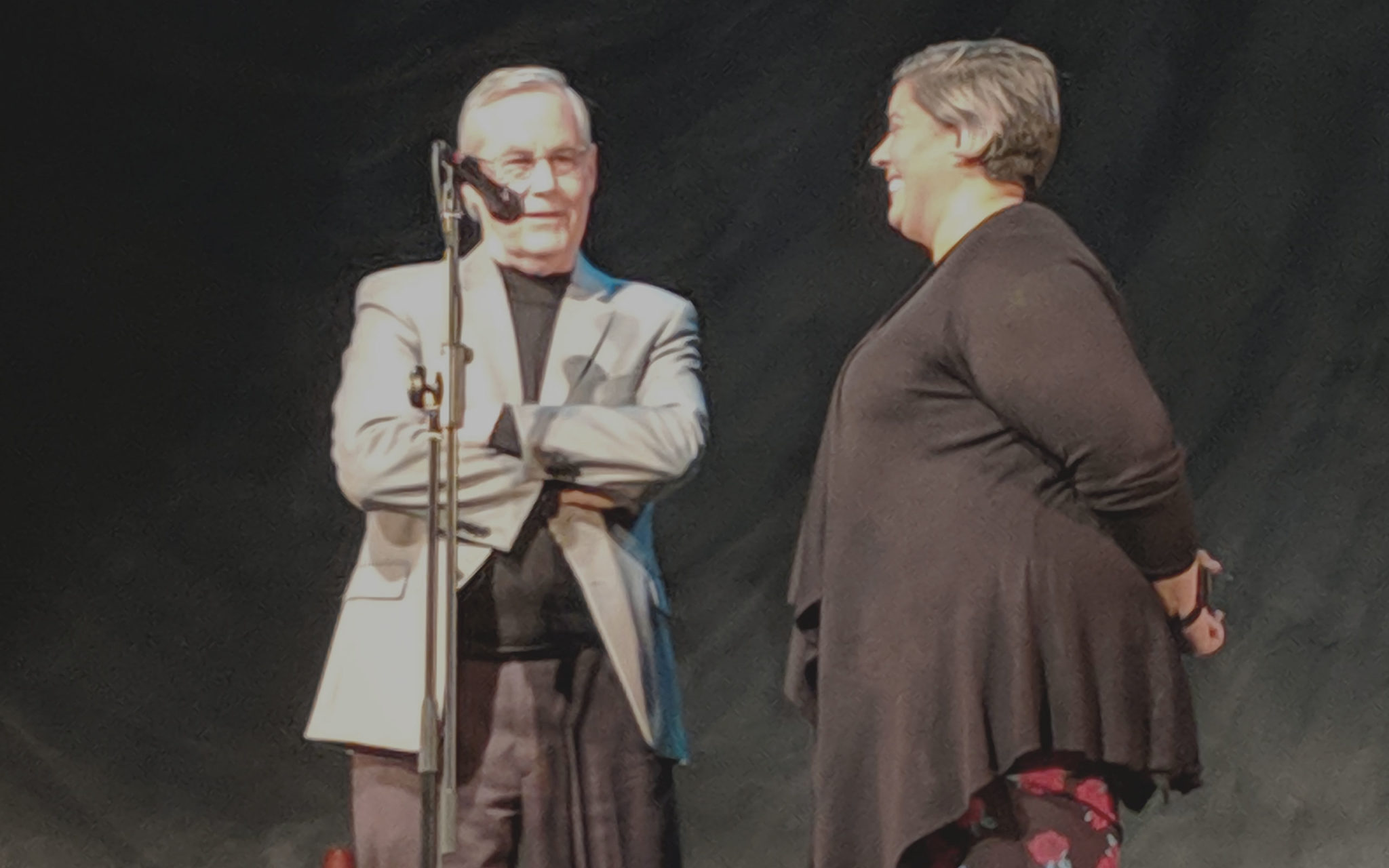 Deacon Rick Birkel and HTP Program Manager Jennifer Lucena speak at a 7 Deadly Sins performance about Kenton Women's Village