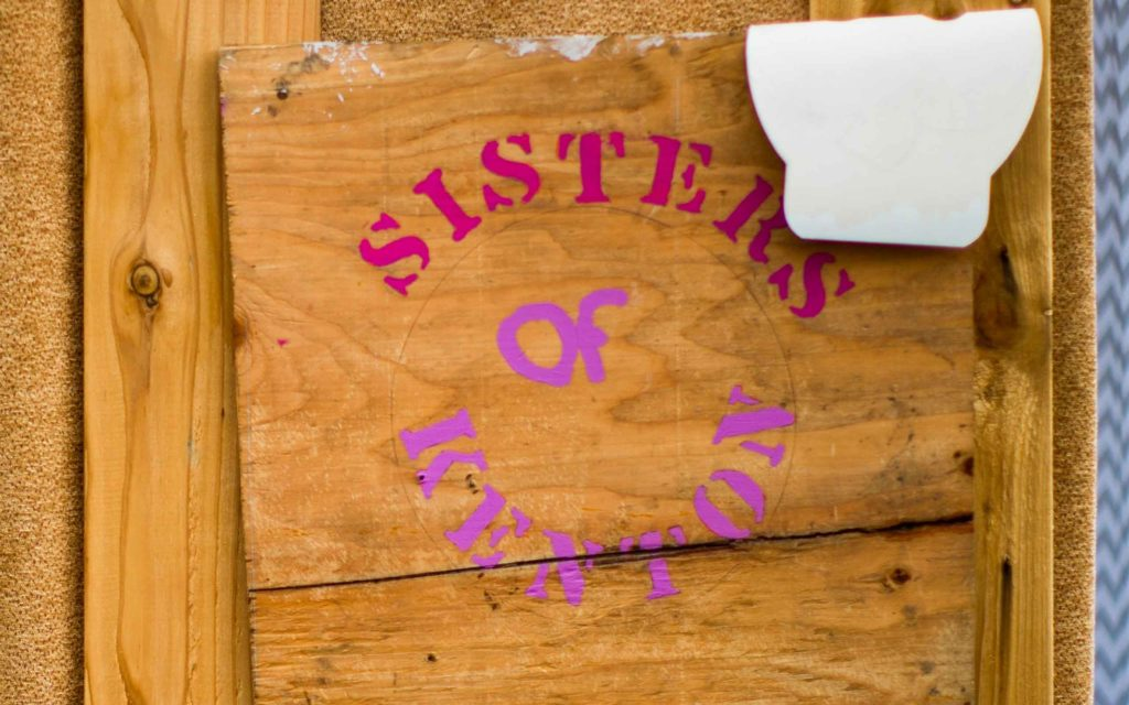 "A sign at Kenton Women's Village that says ""Sisters of Kenton"""