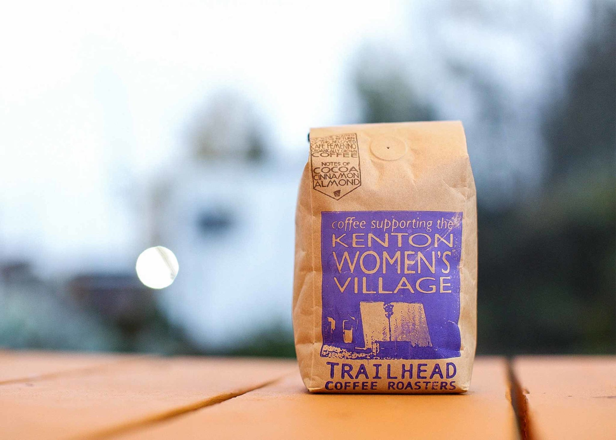 A bag of coffee promoting Kenton Women's Village on the label