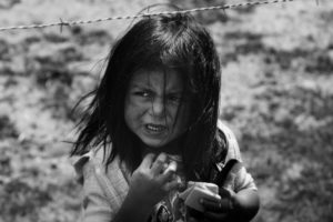 A child behind barbed wire