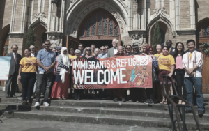 Catholic Charities takes part in a demonstration supporting Oregon's refugee resettlement agencies